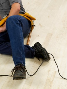 A Chattanooga worker lies on the floor with a workplace injury.
